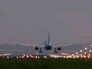 Plane Landing At Airport Background