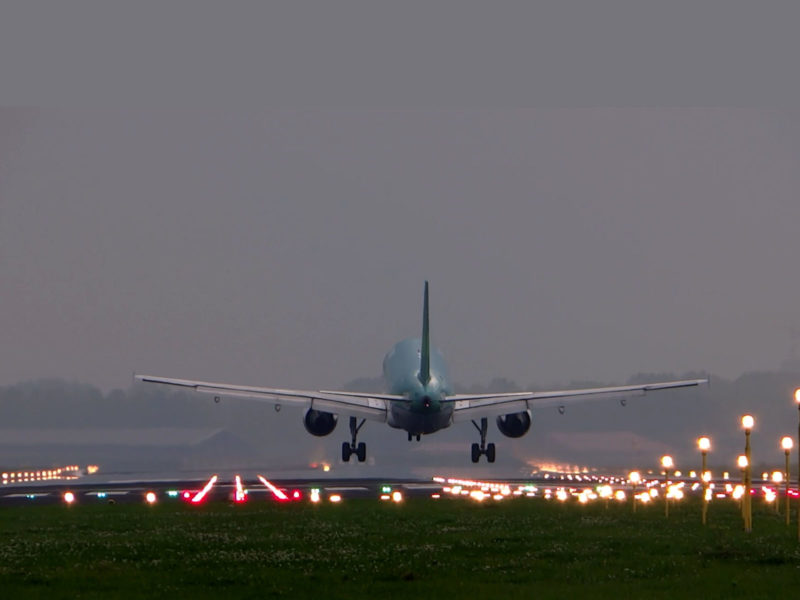 Plane Landing At Airport Background