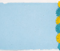 Flowers border on blue paper